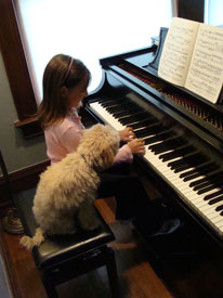 emily and winston at the piano