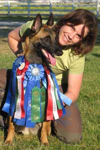 Debbie and Jaz with agility ribbons